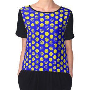 blue and yellow distressed polka dot pattern shirt