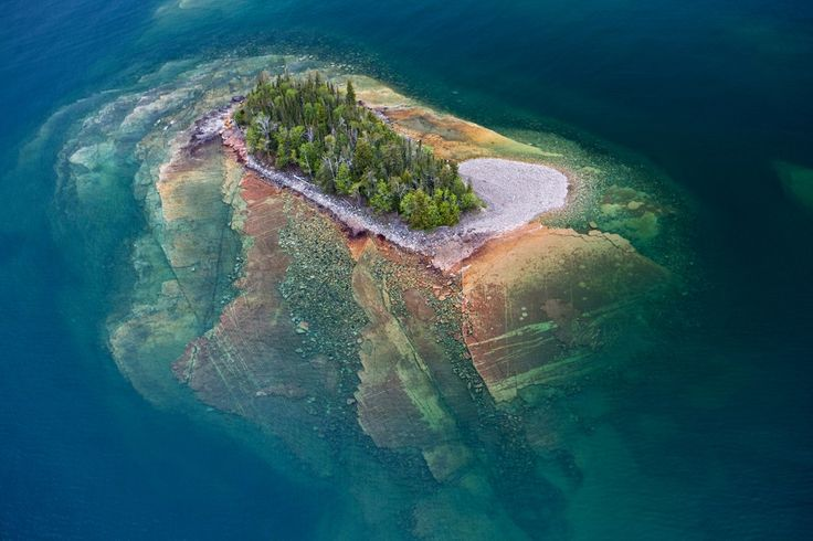 Thunder Bay, Ontario, Canada. Aerial view of small rocky islands with a clear view through the water to the rocks below in Lake Superior, Thunder Bay, Ontario, Canada