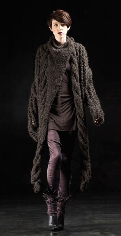 a knitted coat with big cables