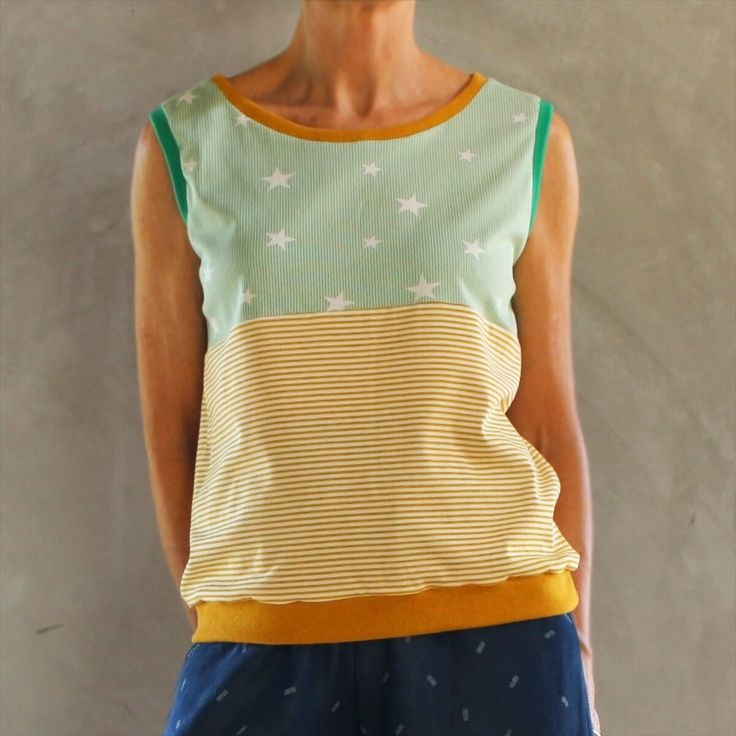 This contrasting mustard and green top has that nerdy funky look that I love! A super comfortable and cool soft cotton sleeveless top that you can wear by itself or layer over a long sleeve T or shirt (sorry but too hot for me to model that look!)