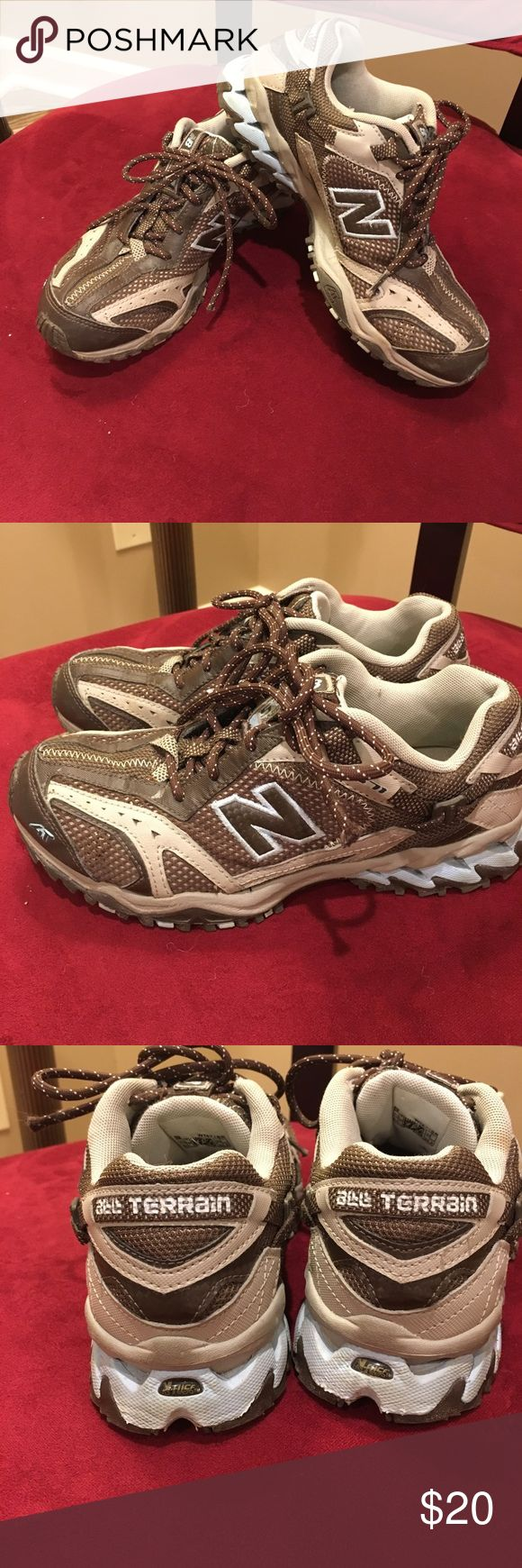 New balance all Terrain hiking trail shoes  571 All terrain new balance 571 hiking shoes. The color is beige and brown with baby blue catching. These are a size 7 1/2. Excellent used condition smoke-free clean home. These do fit true to size New Balance Shoes Sneakers