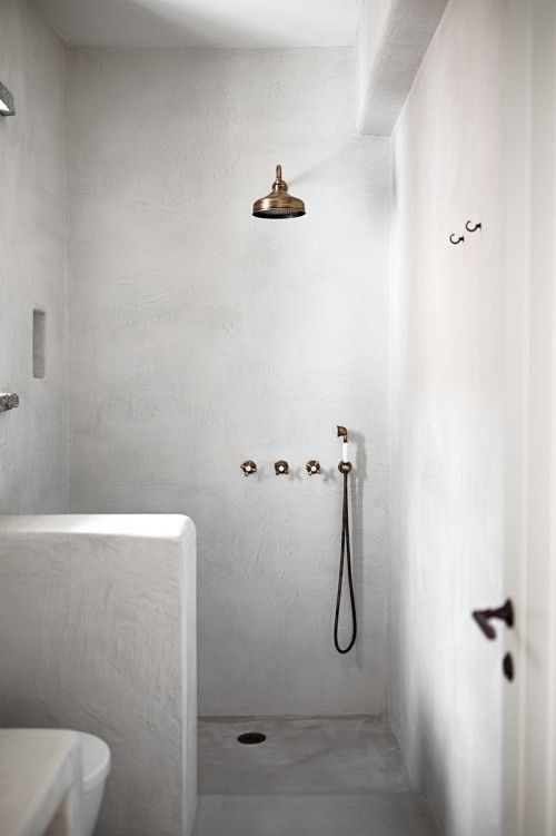 Forged cement technique on entire bathroom makes it practical, minimal and absolutely mesmerizing.
