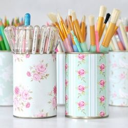 Upcycled tin cans with scrapbooking papers....good for makeup brushes
