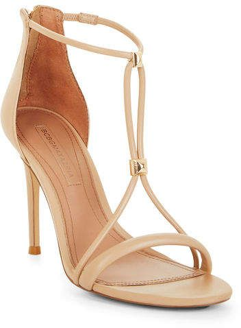 Crafted from smooth leather, this evening sandal stands on a tall stiletto heel and is detailed with high-shine metal studs on its straps for a touch of luxe.  #prom #eveningdresses #sandals #style #stylish #wedding