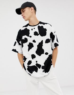 e2bd253124 Shop ASOS DESIGN oversized t-shirt with all over cow print at ASOS.  Discover fashion online.