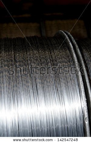 Aluminum wire in a bibins for aluminum conductor - stock photo