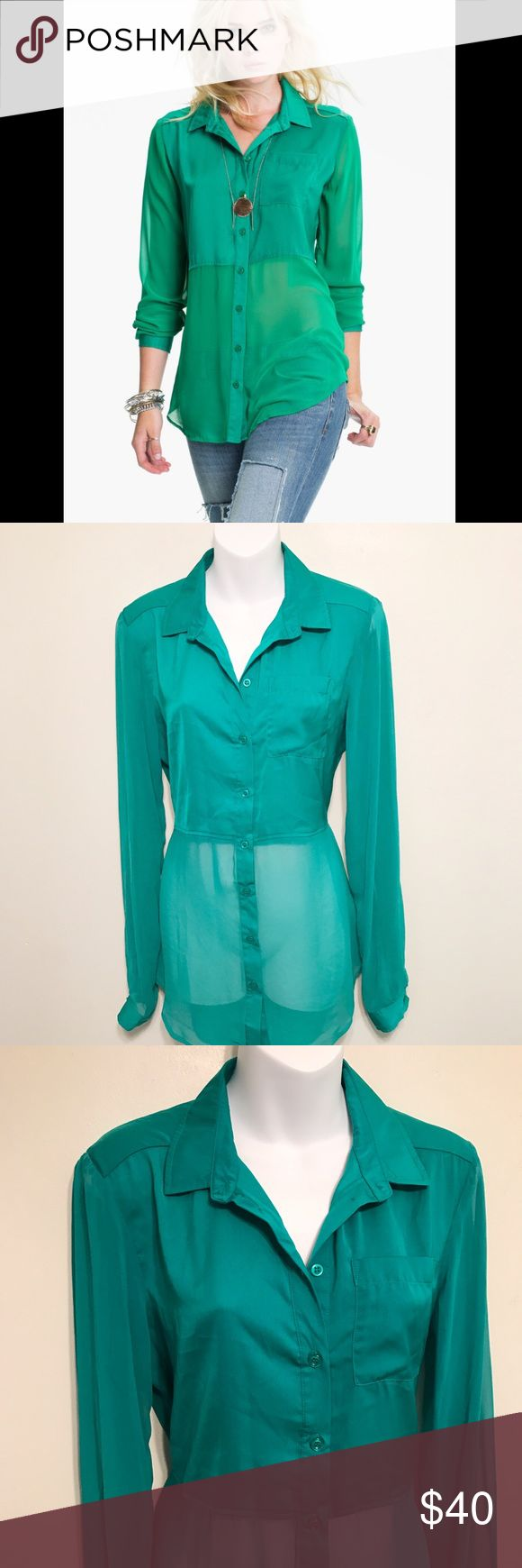 """NWT Free People The Best Of Both Worlds Blouse A solid-satin cropped body and collar define a chic, oversized button-front shirt. Sheer sleeves and panels to the hem add a chic touch to the on-trend yet easy-to-wear style. Single-button cuffs. Approx. length from shoulder: front 30""""; back 35"""". Polyester; machine wash. Size small 4-6 Length- 31"""" Chest- 21"""" pit to pit Arm length- 19"""" pit to opening  One button on each cuff Eight buttons up the front  One chest pocket  Slit open in the back…"""