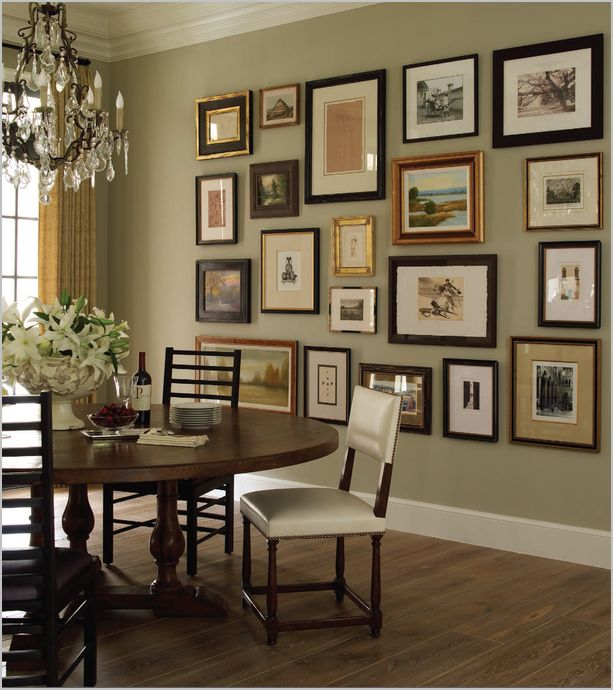 Love this photo wall in dining room idea.