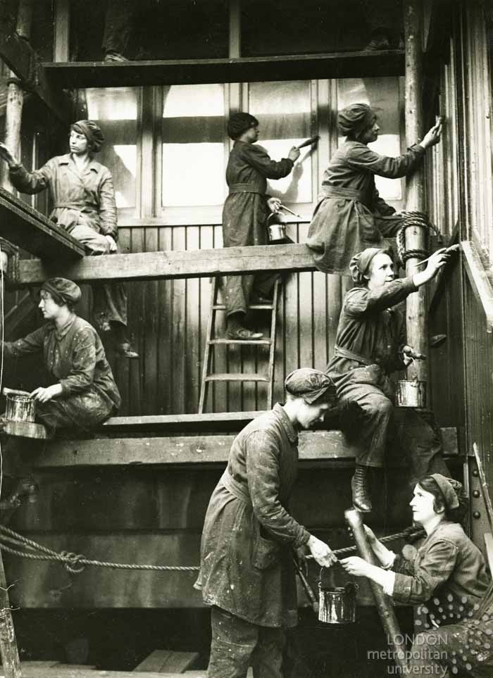 First World War: Women on the Home Front: Railway workers painting a car