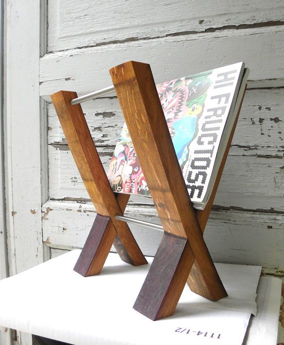 This is one awesome magazine rack!  It is made from the staves of a wine barrel - cool!    http://www.etsy.com/listing/75426789/modern-magazine-rack-reclaimed-wine