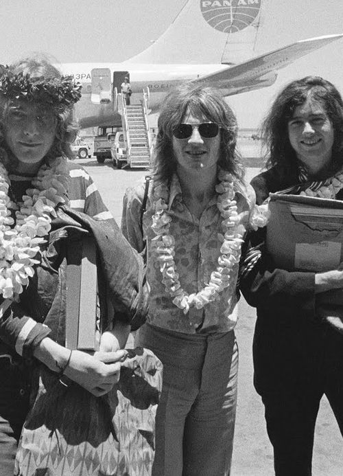 Plant, Jones and Page arriving at Honolulu Airport, holding Led Zeppelin II master tapes, 1969.