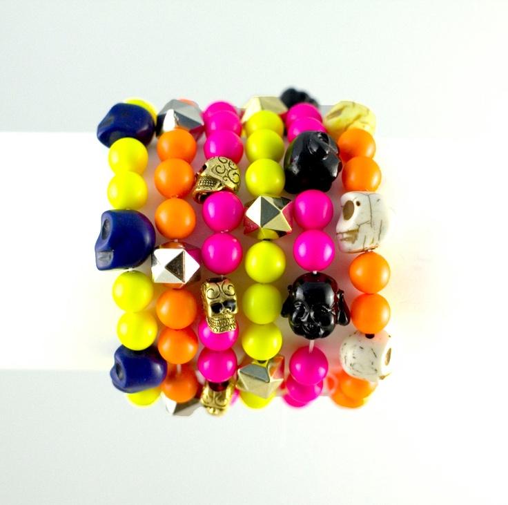 Sweet and Cool! Swarovski beads neon beads neon bracelet metallic diamond cut beads skulls pink orange yellow. $17.00, via Etsy.