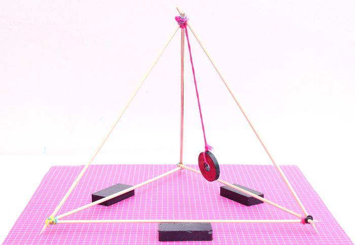 """Explore the magic of magnet science with 4 fun science experiments and our DIY """"magnetic gizmo"""" made from skewers and a donut magnet."""