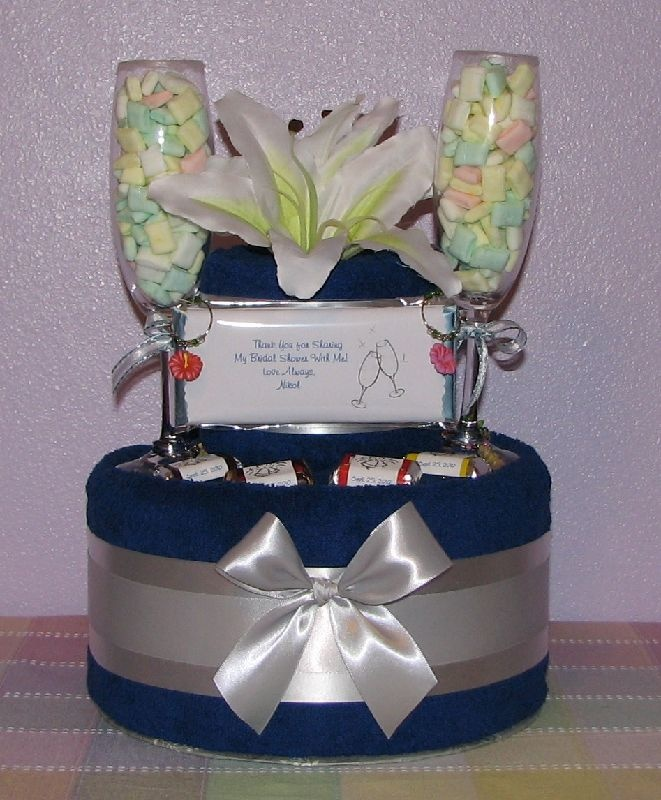 Google Image Result for http://customtowelcakes.com/Gift_Basket_Photo_Gallery/slides/Champagne-Towel-Ckae.JPG