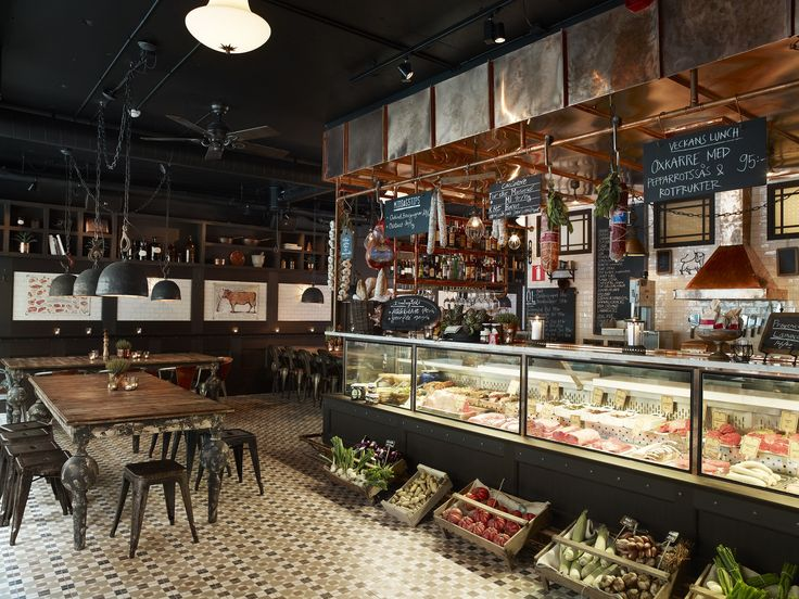 interesting copper detail around kitchen area, kind of frames it in but still open feel, storage possibilities behind? love the rail with menu boards and things hanging from it