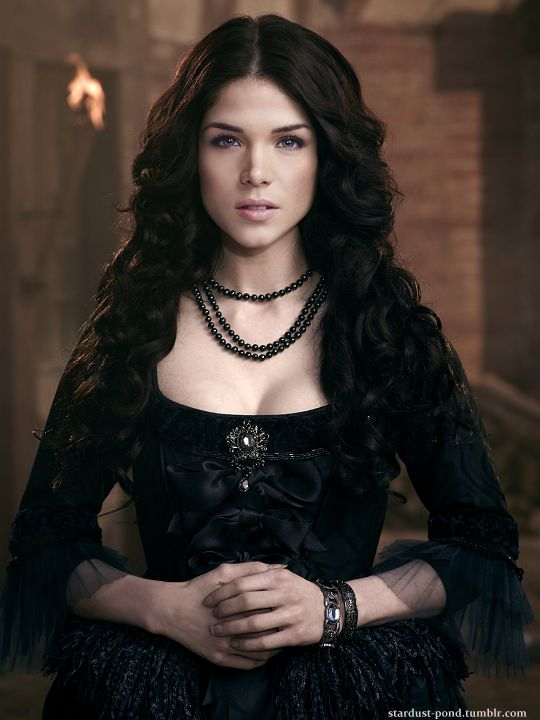 it's like an older, evil Amity... like if Haidor had gotten to her before Roan did...