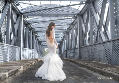 Destination Style - Dramatic Entrances with Zahavit Tshuba  Deniz  Two tone trumpet gown featuring clear beads and sequins. Long sleeves, silk organza and soft tulle hand in the skirt compliment the extra deep V neckline, open legs, and open back.  http://theantibridezilla.com/post/121974483587/photoset_iframe/theantibridezilla/tumblr_nq871yX0W51rmrycv/500/false