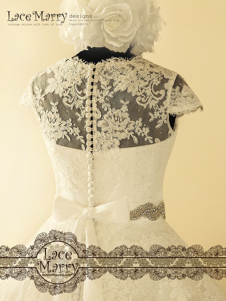 Sheer Lace Back is having a row of Vintage Style Buttons with Loops in the middle!!!