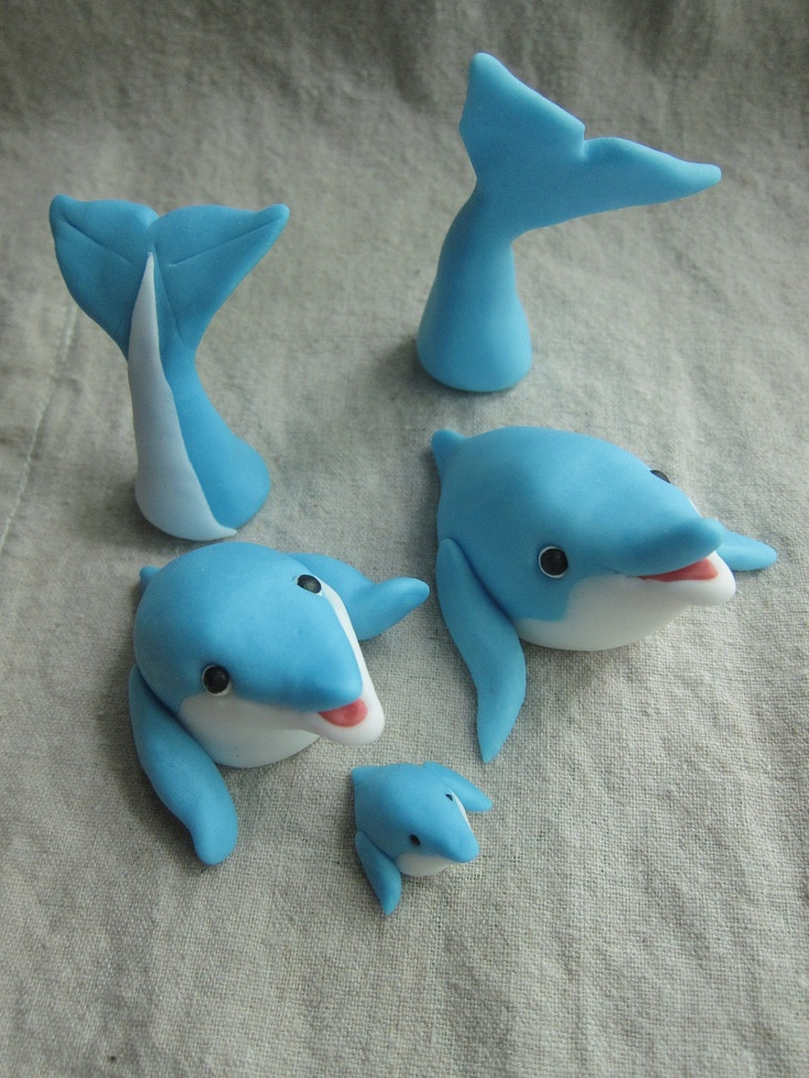 Dolphin Family Cupcake Toppers (12 items ). $39.00, via Etsy. Might have to try my hand at fondant...