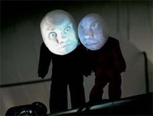 Switch (1996), by Tony Oursler—a series of faces and features projected onto fiberglass. Surreal.