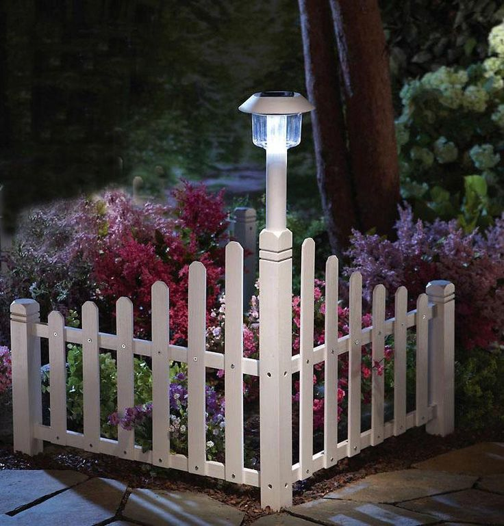 White Picket Fence Corner Lawn Edging W/ Solar Light. This would be easy to make with wooden pickets. Very pretty for corner of the front yard!