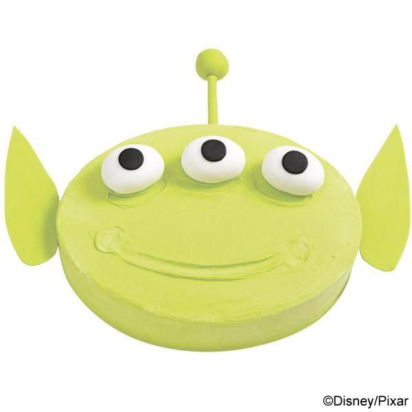 Toy Story Alien Cake - Serve a green Disney•Pixar Toy Story alien cake and all eyes will be on your next celebration!   The bright color is easy to make combining Lemon Yellow and Leaf Green Icing Colors.