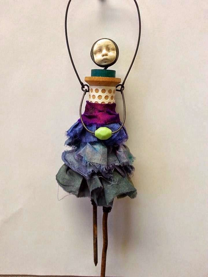 use a thread spool. Carla Trujillo - Mixed Media Artist