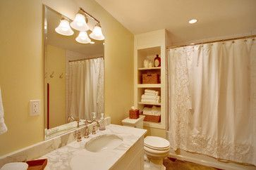 Shelve Your Storage Woes If your bathroom has dead space beside the tub, make use of it! These cubbies were created out of the space between studs and provide storage without any loss of space, while looking great.