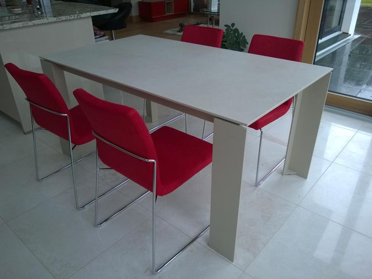 Dining set with Tavole ceramic top extendable dining table with Layla in red colour. Modern and stylish dining set delivered to our client in Cambridge.