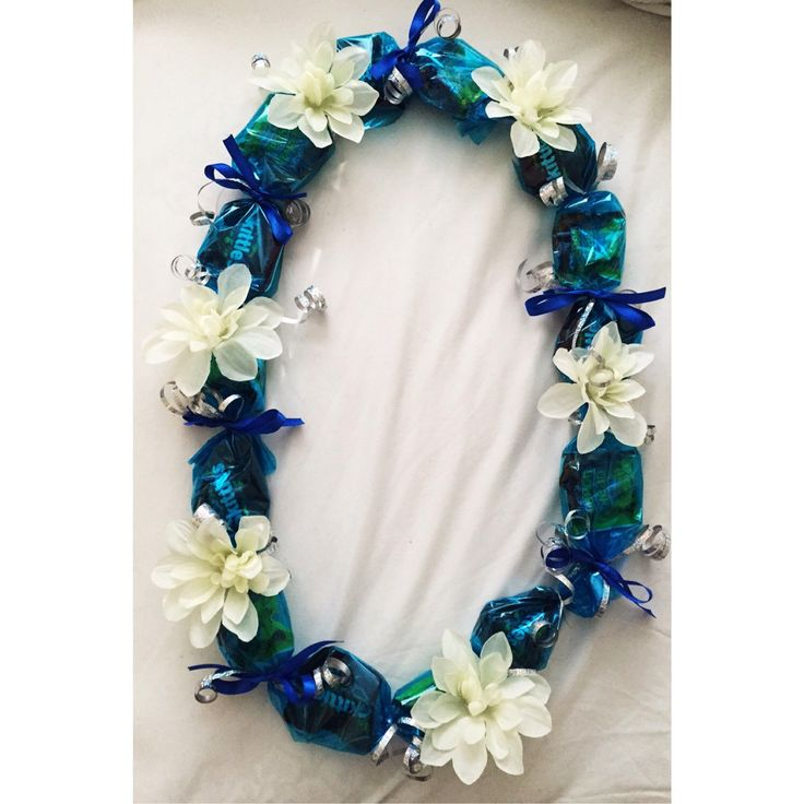 Blue Candy Lei with White Flowers by LindsaysLeis on Etsy https://www.etsy.com/listing/227972641/blue-candy-lei-with-white-flowers