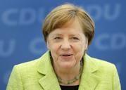 MERKEL CELEBRATES GERMAN ELECTION WIN, CHALLENGER DEFLATED