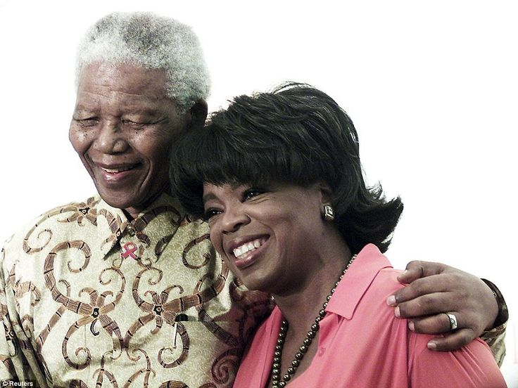 Talk show host and political giant: Former South African president Nelson Mandela (L) poses with television personality Oprah Winfrey in Henley, Johannesburg, in this December 6, 2002