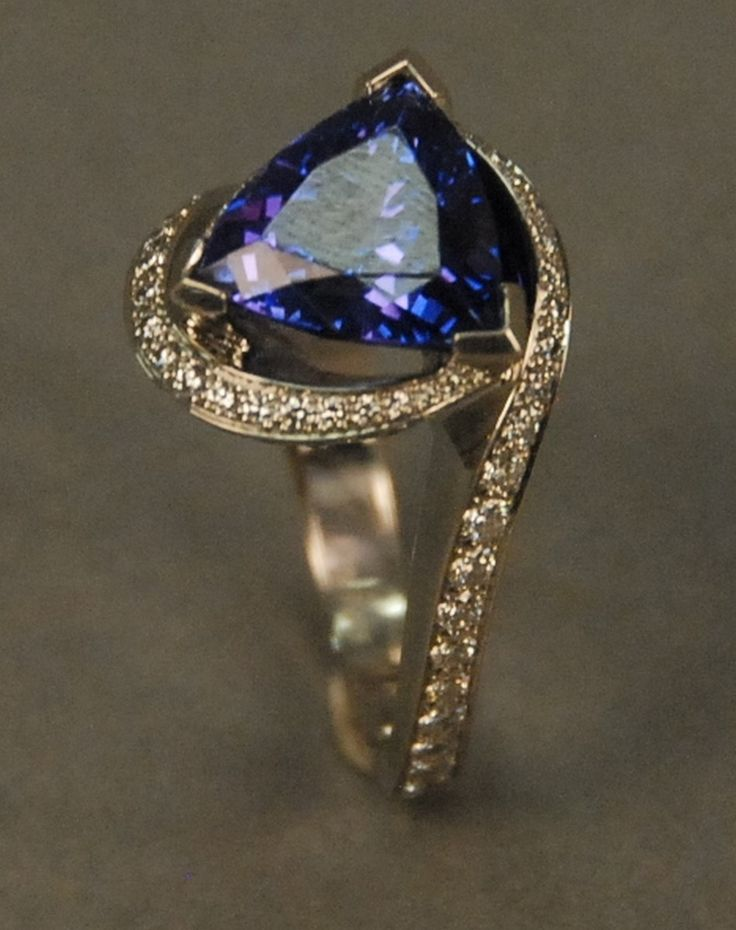 Mark Schneider platinum ring set with trillion cut tanzanite and mounted with inset diamonds sold along with Mark Schneider pamphlet, 1st Place Winner International Platinum Guild Design Award. 30.5 grams -  Realized Price: $5,100.00