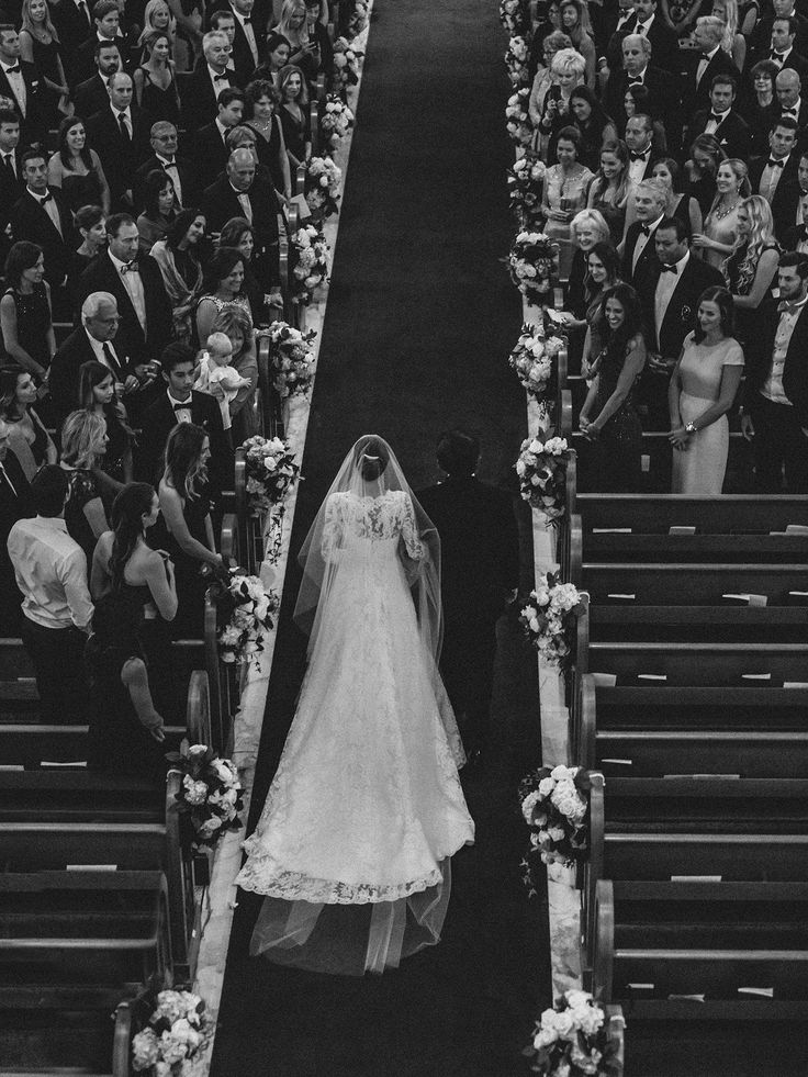 """My dad and I walking down the aisle to the """"Bridal Chorus."""" The aisle seemed like it went on forever! Thank goodness I had him by my side."""