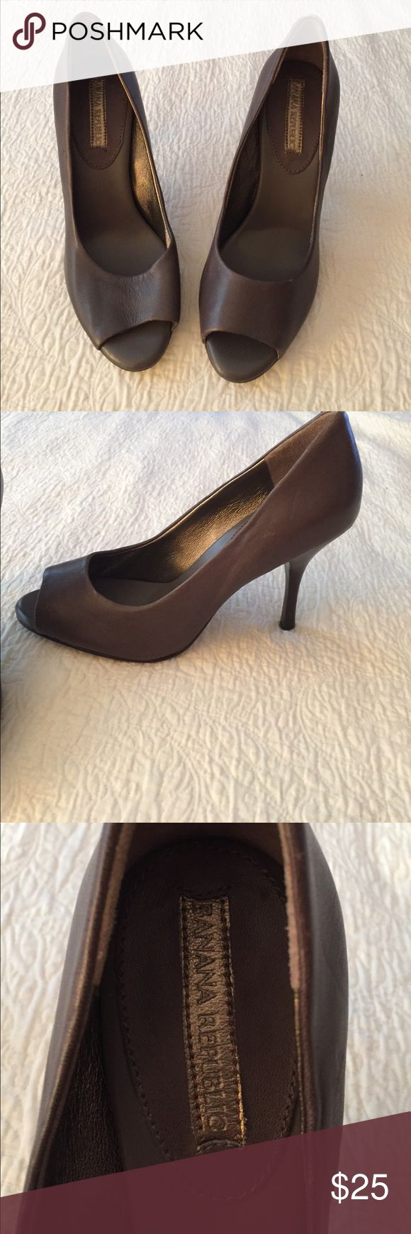 Banana Republic Heel Peep Toe, size 7, dark gray leather, slight wear on back of left heel (pictured) but not noticeable. Not much wear on bottom, 3 inch heel and in good condition. Banana Republic Shoes Heels