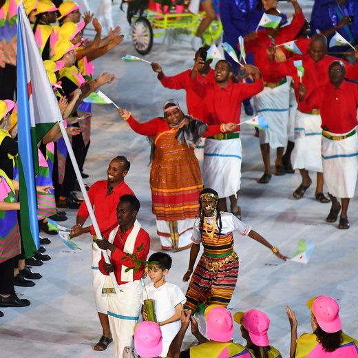 Djibouti's flag bearer Abdi Waiss Mouhyadin leads his national delegation during the opening ceremony of the Rio 2016 Olympic Games at…
