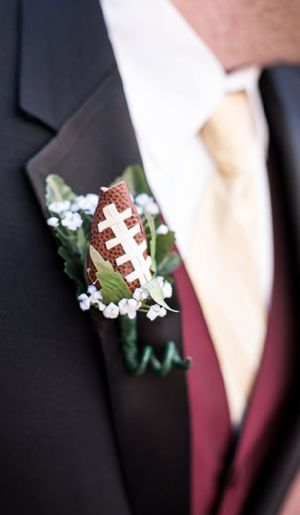 Football Rose Boutonnieres can be that subtle accent that you need to really round out your football themed wedding.  Find yours today at SportsThemedWeddings.com sports weddings, sport themed wedding ideas #wedding