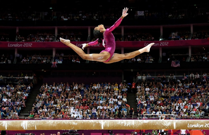 Gabby Douglas - Look at that height and split!