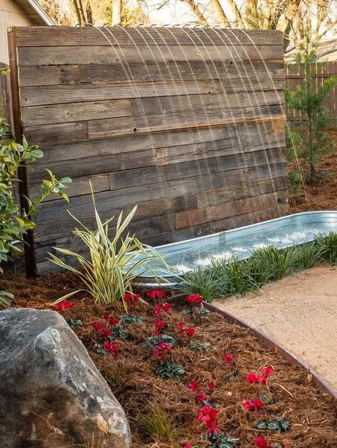 """A Low Cost Water Feature. You'd need... 4 to 6 pallet's, 1 water trough, 1""""dia. x 8ft. long piece of copper or PVC pipe [to drill holes in], a recycling fountain pump, a garden hose or more pipe to hard plumb it in between your home and the fountain. Then install your landscaping material, sit back and enjoy."""