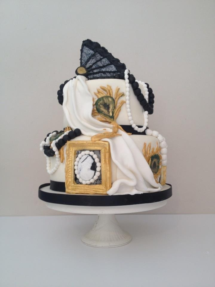 1920s cake for 40th bday - My customer sourced an image of a gorgeous cake by Cake Coquette. This is my recreation. The fan is made in individual sections using a sugarveil mat to emboss the lace. i then painted the raised lines with black gel colour.