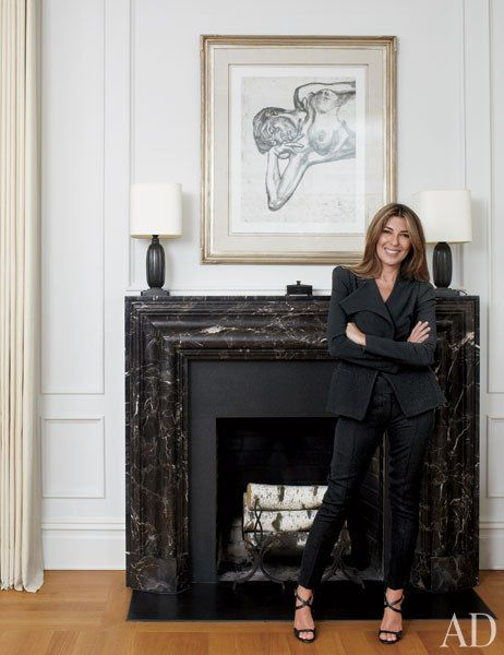 Nina Garcia in her New York City apartment, which was renovated and decorated by Carlos Aparicio of Aparicio   Assoc. The nude is by Lucian Freud, the 1920s lamps are by Just Andersen from BAC, and the marble mantel is from Chesney's.