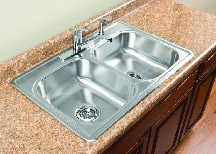 The Tuscany™ Double Bowl Stainless Steel Kitchen Sink Features A Matching  Side Spray, Strainers And Sink Clips.