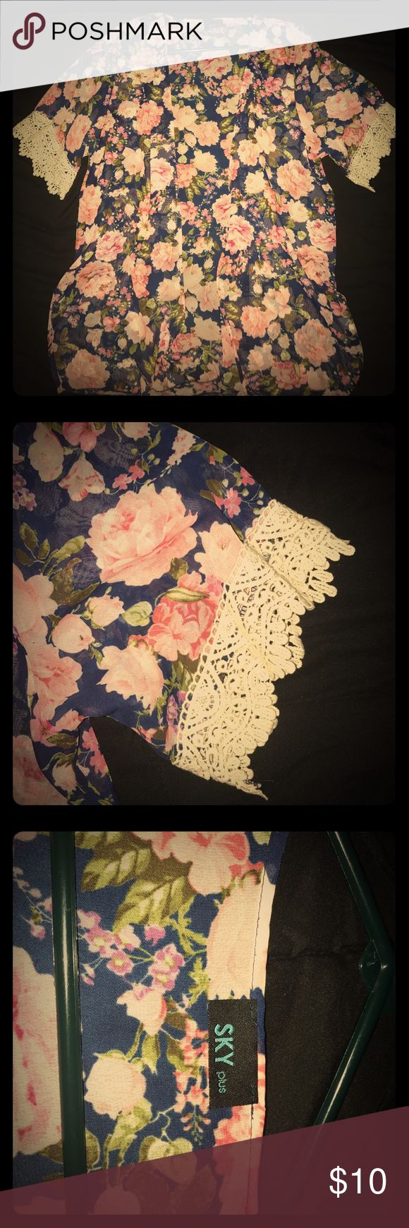 Flower shawl Sorry I tried to pick a good filter that really brought out the warmth in these colors, but the shawl is super thin light weight material with a cream lace attached to the arm area. Worn once and is in perfect condition🌺 SKY plus Other