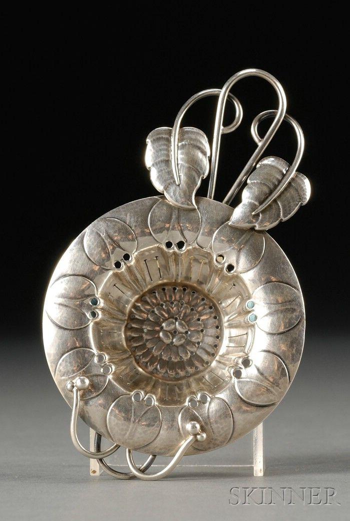 Georg Jensen Tea Strainer No. 2, sterling silver, from Denmark. Reticulated leaf pattern with loop & leaf handle, 4.875 in length. via Skinner