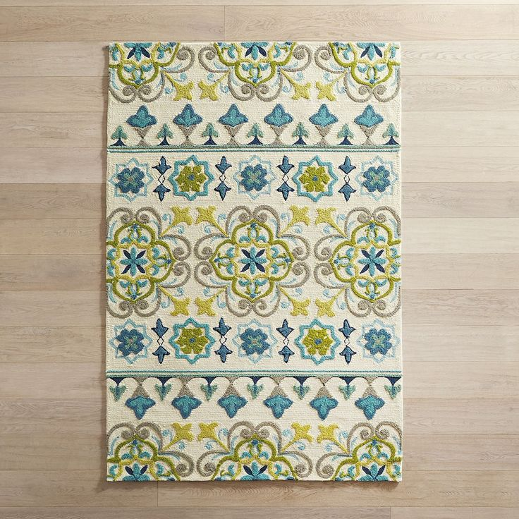Inspired by Mediterranean tiles, our rug will look stunning indoors or out. It's UV-resistant and cleans up with just a rinse from a garden hose. Perfect for patios or anywhere you need a gorgeous easy-to-clean rug.