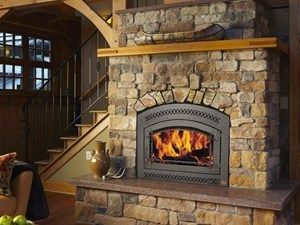 36 Elite The catalytic 36 Elite wood fireplace, shown with the Classic Arch face, heats like a furnace and always attracts admiring glances. It features high efficiency cheery flames and Posi-Pressure™ heating through a quiet, remotely located 388 CFM fan which circulates the heat throughout the home