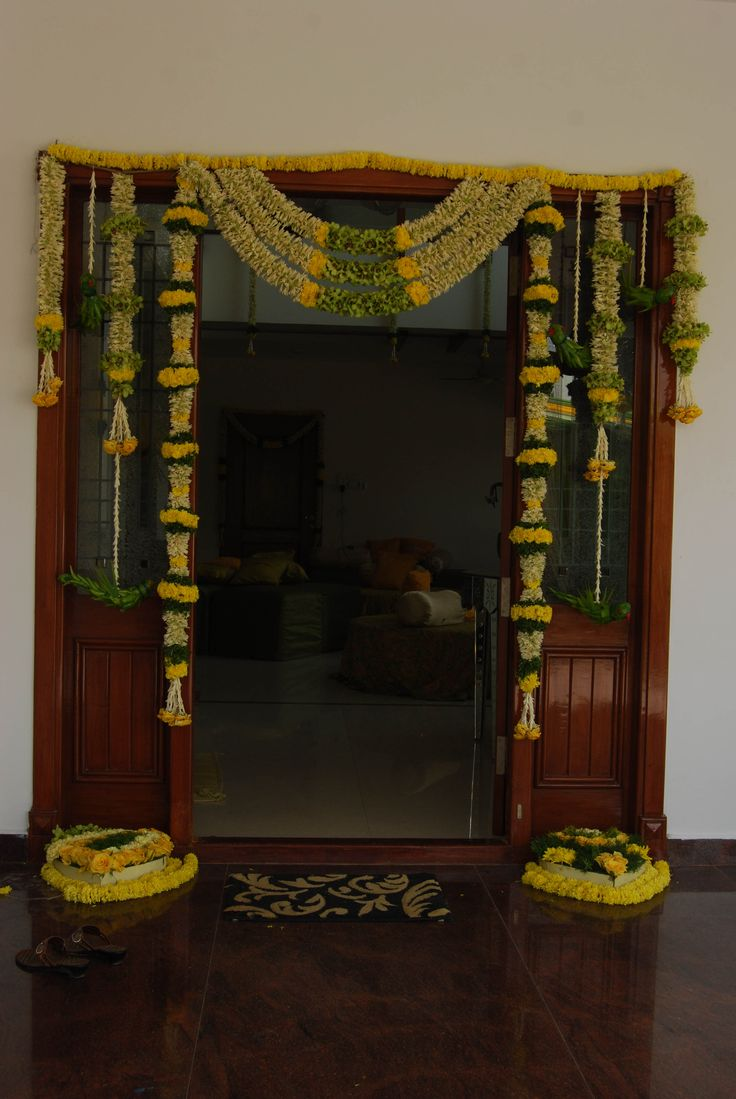 Door framed by flowers and green leaves pasupu kottadam for Wedding door decorating ideas