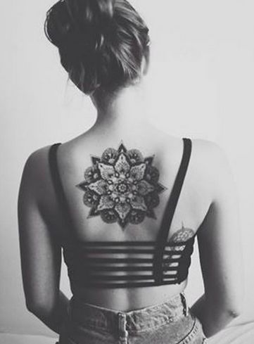 a little too big for me, but this back tattoo is just too awesome on this girl