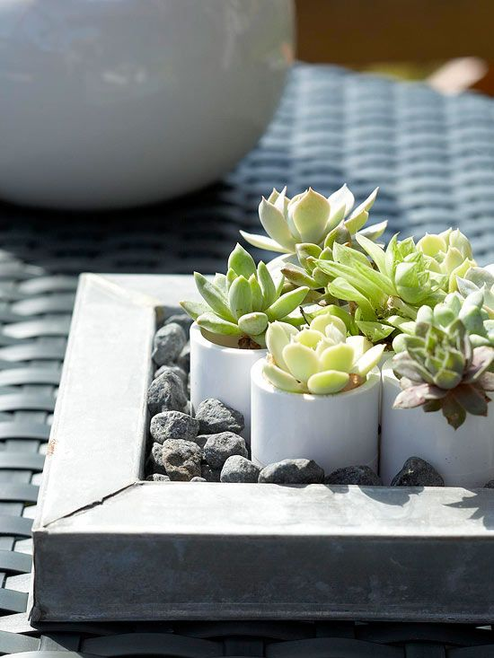 Incorporate Tabletop Texture and Color  Small vases and containers are a good way to add artful accents to outdoor living spaces, either on side tables or dining areas. Here, the mini pots can be set at individual places for a more formal outdoor gathering or gathered in a larger vessel for impact.