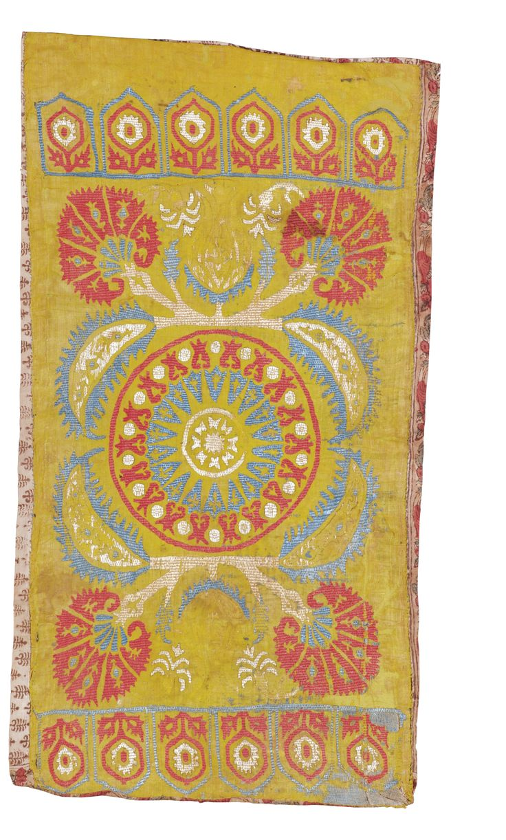 Kaitag silk embroidered yastik, Ottoman,  of rectangular format, embroidered in polychrome silks in red, blue and ivory on a yellow ground, with a central medallion surrounded by four serrated leaves and stems placing carnations in each corner, and flanking archichoke motifs, with two narrow compartmentalised borders enclosing foliate flowering stems, with a block printed reverse lining      Approximately 56 by 99cm.; 1ft. 10in., 3ft. 3in.  17th century